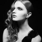 Retro portrait of inaccessible beautiful womanl in black dress w — Stock Photo
