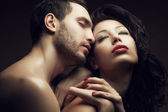 Emotive portrait of two lovers - handsome man and gorgeous woman — Stock Photo