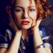 Portrait of a beautiful young red-haired model in trendy jacket. — Stock Photo