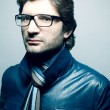 Portrait of a fashionable handsome man in blue jacket with strip — Stock Photo
