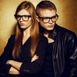Portrait of gorgeous red-haired fashion twins in black clothes w - ストック写真