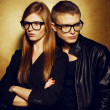 Portrait of gorgeous red-haired fashion twins in black clothes w - Stockfoto