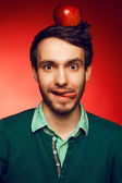 Portrait of a happy and mad student guy posing over red backgrou — Stock Photo