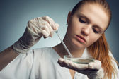 Portrait of young woman - scientist with dropper working at the — Stock Photo
