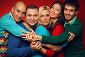 Portrait of five stylish close friends hugging, smiling and posi — Stock Photo