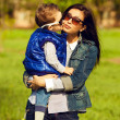 Portrait of fashionable baby boy and his gorgeous mother (hollyw — Stock Photo #26061863