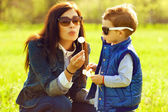 Portrait of fashionable baby boy and his gorgeous mother in tren — Stock Photo