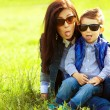Portrait of fashionable baby boy and his stylish mother in trend — Stockfoto