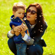 Portrait of fashionable baby boy and his gorgeous mother in tren — Foto de Stock