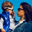 Portrait of fashionable baby boy and his gorgeous mother (hollyw — Stock Photo