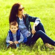 Portrait of fashionable baby boy and his stylish mother in trend — Foto Stock