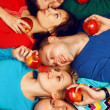 Portrait of five stylish close friends hugging and lying over re — Stok fotoğraf