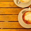 Latte art concept. Two cups with cappuccino (hot coffee with mil — Stock Photo #26446551