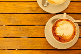 Latte art concept. Two cups with cappuccino (hot coffee with mil — Stock Photo