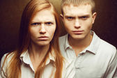 Emotive portrait of angry gorgeous red-haired fashion twins in w — Stock Photo