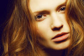 Emotive portrait of a young beautiful girl with long ginger (red — Stock Photo