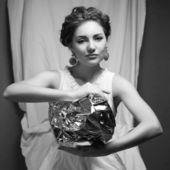 Arty portrait of a fashionable queen-like model holding silver f — Stock Photo