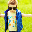 Stylish baby boy with ginger (red) hair in trendy sunglasses and — Foto Stock