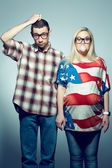 Funny pregnancy concept: portrait of two hipsters (husband and w — Photo