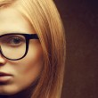 Stylish eyewear concept. Portrait of a young beautiful red-haire — Stock Photo #27704167