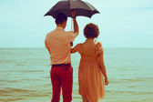 Summer vacation concept. Couple standing on beach near water and — Stock Photo