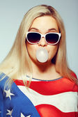 American Mom Concept: Young pregnant woman in american flag like — Stock Photo