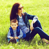 Portrait of fashionable baby boy and his stylish mother in trend — Stock Photo