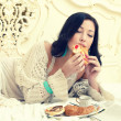 Foto de Stock  : Tasty breakfast concept. Portrait of a young beautiful woman eat