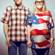 Постер, плакат: Funny pregnancy concept: portrait of two hipsters husband and w