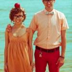 Nerds' honeymoon concept. Portrait of couple of young happy marr — Stock Photo