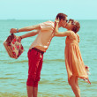 Couple walking on beach. Young happy married hipsters in trendy — Foto de Stock