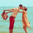 Couple walking on beach. Young happy married hipsters in trendy — Foto Stock