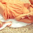 Summer picnic concept. Portrait of a happy young woman lying at — Stock Photo