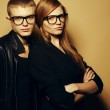 Portrait of gorgeous red-haired fashion twins in black clothes w — Stock Photo