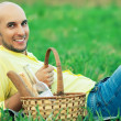 Weekend picnic concept. Portrait of a young handsome bald man in — Stockfoto