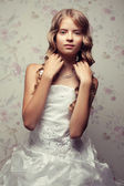 Portrait of a little princess in white vapory classic dress with — Stock Photo