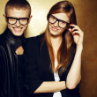 Eyewear concept. Portrait of gorgeous red-haired twins in black  — Стоковая фотография