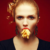 Unhealthy eating. Junk food concept. Arty portrait of fashionabl — Stok fotoğraf