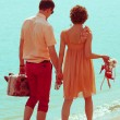 Couple walking on beach. Young happy married couple walking on b — Stock Photo