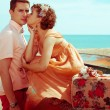 Happy honeymoon (vacation) concept. Young married couple of hips — Stock Photo #31614279