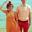 Nerds' honeymoon concept. Portrait of couple of young happy marr — Stock Photo