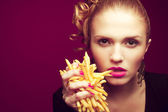 Unhealthy eating. Junk food concept. Girl eating fries — Stock Photo