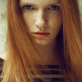Emotive portrait of a fashionable model with red (ginger) hair a — Stock Photo