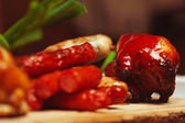 Set of fried meat and small meat sausages served with scallion o — Stock Photo
