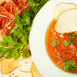 Tomato soup with smoked bacon and fresh parsley on a wooden boar — Stock Photo