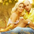 Romantic picnic concept. Portrait of a young loving couple in tr — Stock Photo #44910877