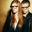 Eyewear concept. Portrait of gorgeous red-haired fashion twins i — Stock Photo #45174335