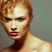 Emotive portrait of a fashionable model with red (ginger) curly  — Stock Photo