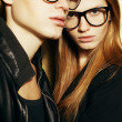 Eyewear concept. Family portrait of gorgeous blond fashion twins — Stock Photo #45870345