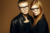 Eyewear concept. Portrait of gorgeous blond fashion twins in bla — Stock Photo